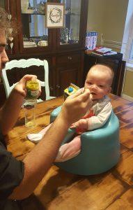 Ben feeding Elliot peas